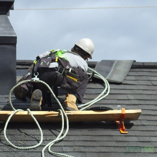 A Roofer Installs Asphalt Shingles.