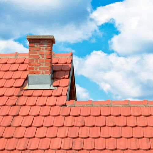 A Tile Roof With Chimney