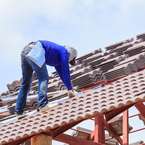 Roofers Install Tile Roofing.