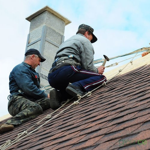 Roofers Install an Asphalt Shingle Roof.