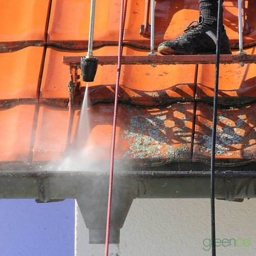 Using Pressure Washer to Remove Grime During Roof Washing Process