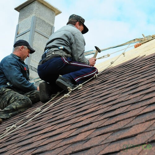Contractors Working on a Residential Roof Installation