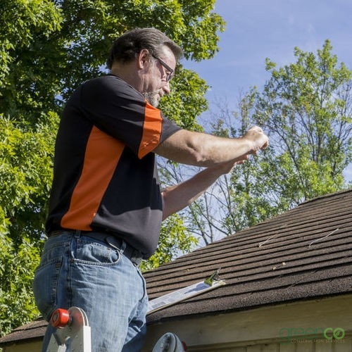 Insurance Adjuster Viewing Roof Insurance Claim