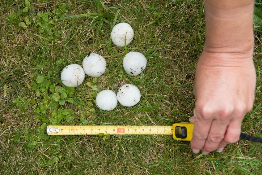 Measuring Hail After Roof Hail Damage Repair
