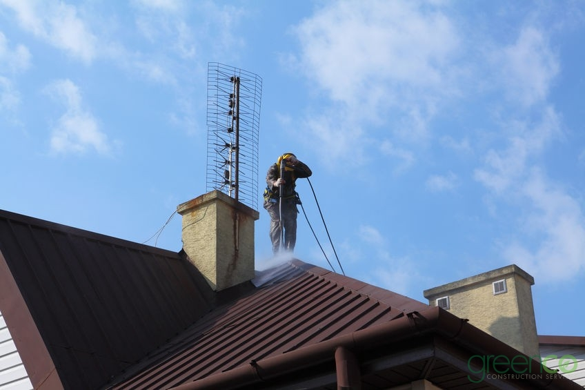 Roof Washing Being Completed With a Pressure Washer